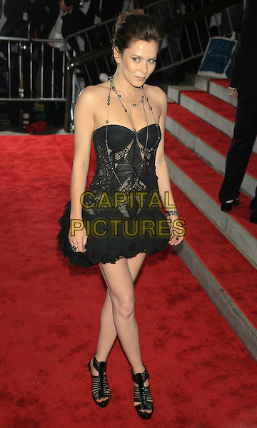 "ANNA FRIEL.Met Costume Institute Gala Benefit - ""The Model as Muse: Embodying Fashion"".at the Metropolitan Museum of Art, New York, NY, USA..May 4th, 2009 .full length strapless dress black lace ankle boots sandals silver necklaces .CAP/LNC.©TOM/LNC/Capital Pictures."