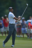 Bethesda, MD - June 27, 2014: Tiger Woods follows the ball after his second shot on hole 4 in the second round of play at the Quicken Loans National at the Congressional Country Club in Bethesda, MD, June 27, 2014. The tournament was Woods first since he underwent back surgery earlier in the year. He finished the round at +4, missing the cut. (Photo by Don Baxter/Media Images International)