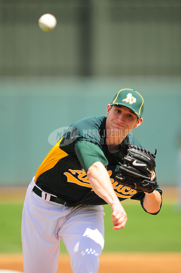 Mar. 19, 2012; Phoenix, AZ, USA; Oakland Athletics pitcher Jarrod Parker throws in the second inning against the Arizona Diamondbacks during a spring training game at Phoenix Municipal Stadium.  Mandatory Credit: Mark J. Rebilas-