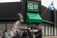 A line of customers formed on the first day of cannabis legalization at a SQDC (Societe quebecoise du cannabis) store in Quebec city, Canada, 17 October 2018.