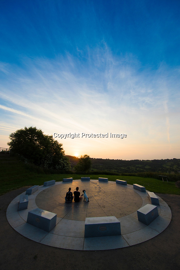 21/06/17<br /> <br /> A couple and their dog watch the summer Solstice sun rise at the StarDisc amphitheatre above Wirksworth, in the Derbyshire Dales.<br /> <br />  <br /> All Rights Reserved F Stop Press Ltd. (0)1773 550665 www.fstoppress.com