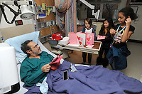 NWA Democrat-Gazette/ANDY SHUPE<br /> Bertrand Couture (from left), a veteran of the U.S. Army from Blue Eye, Mo., speaks Tuesday, Feb. 14, 2017, with Liam Pedworth, 9; Suri Xiong, 9; and Olivia Johnson, 10; all students at Washington Elementary School in Fayetteville, after they gave Couture handmade Valentine's Day cards in his room at Veterans Health Care System of the Ozarks in Fayetteville. Visitors including law enforcement, University student-athletes and educators distributed cards to veterans at the facility.