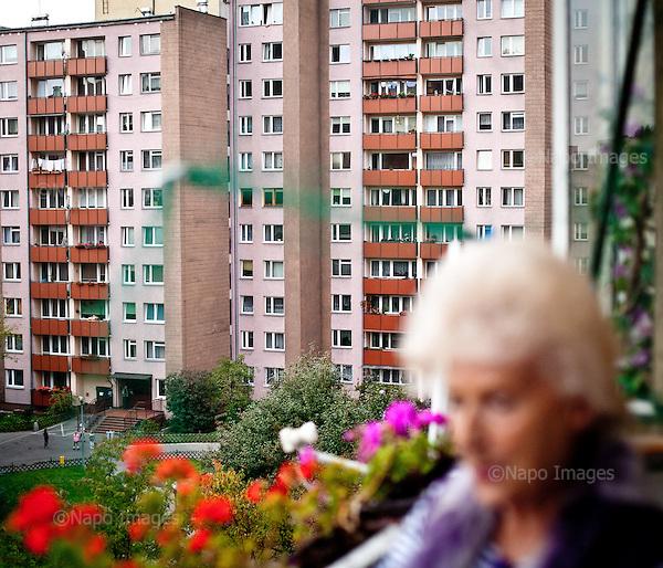 WARSAW, POLAND, NOVEMBER 2011:.Wika Szmyt, 74 year old DJ, standing on balcony of her flat..Wika is famous in Poland for being the oldest DJ. Twice a week she runs discos at the Bolek club in Warsaw, frequented mainly by the pensioners..(Photo by Piotr Malecki/Napo Images)..WARSZAWA, LISTOPAD 2011:.DJ Wika stoi na balkonie swojego mieszkania. Wika Szmyt, 74-letnia DJ jest znana jako najstarsza didzejka w Polsce. Dwa razy w tygodniu prowadzi dyskoteki w klubie Bolek, na ktore przychodza glownie emeryci..Fot: Piotr Malecki/Napo Images.***ZAKAZ PUBLIKACJI W TABLOIDACH I PORTALACH PLOTKARSKICH*** .*** Zdjecie moze byc uzyte w prasie, gdy sposob jego wykorzystania oraz podpis nie obrazaja osob znajdujacych sie na fotografii ***.