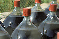 Demi-johns (demi-jeannes) of ageing Banyuls wine stored traditionally outside in the sunshine, Domaine Clos des Paulilles, banyuls Roussillon, France