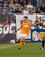 Houston Dynamo defender Richard Mulrooney (8) clears the ball. The New England Revolution defeated Houston Dynamo, 1-0, at Gillette Stadium on August 14, 2010.