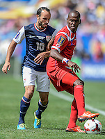 Chicago, IL - Sunday July 28, 2013:  United States forward Landon Donovan (10) battles with Panama's Leonel Parris  (2) during the CONCACAF Gold Cup Finals soccer match between the USMNT and Panama, at Soldier Field in Chicago, IL.