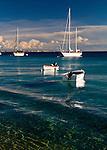Kralendijk, Bonaire, Netherland Antilles -- Moored boats float atop crystal clear Caribbean water in the anchorage at Kralendijk, Bonaire.