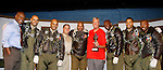 Buffalo Bills Rex Ryan (head coach NFL's Buffalo Bills) is presented an award by Black Angels' Over Tuskegee Melvin Huffnagle (3rd left - home town is Buffalo) as castmates watch L to R: Thaddeus Daniels, Delano Barbosa, Melvin Huffnagle, Craig Colasanti, Layon Gray, Rex Ryan, David Roberts, Jeantique Oriol,  Lamar Cheston - cast which performed a private performance for Buffalo Bills' head coach Rex Ryan and the team players on September 8, 2015 at Shea Performing Arts Center, Buffalo, New York. (Photo by Sue Coflin/Max Photos)