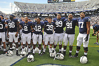 07 September 2013:  Penn State teammates C.J. Olaniyan (86), Jake Kiley (2), Jordan Smith (12), Jesse Della Valle (39), Austin Johnson (99), DaQuan Jones (91), and Garry Gillium (77) sing the alma mater together with the student section after the game. The Penn State Nittany Lions defeated the Eastern Michigan Eagles 45-7 at Beaver Stadium in State College, PA.