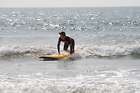 Tom , young boy surfing a foam surfboard atGodrevy , Cornwall , July 2011 pic copyright Steve Behr / Stockfile