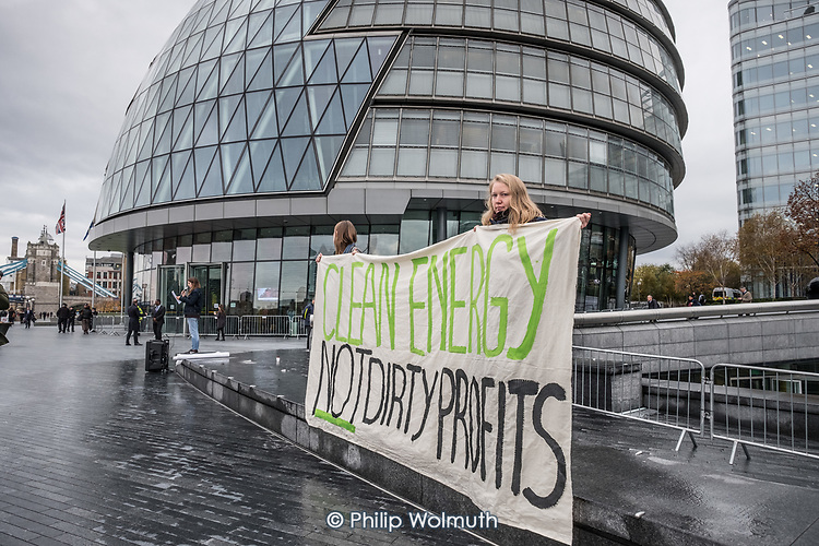 Switched On London environmental campaigners demonstrate outside City Hall  to demand London Mayor Sadiq Khan keeps his climate promises.