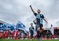 Matthew Bloomfield of Wycombe Wanderers gives supporters a thumbs up as he enters the pitch during the Sky Bet League 2 match between Wycombe Wanderers and Portsmouth at Adams Park, High Wycombe, England on 28 November 2015. Photo by Andy Rowland.