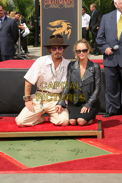 JOHNNY DEPP & VANESSA PARADIS .Honored with a Hand and Footprint Ceremony at Graumann's Chinese Theatre, Hollywood,.Los Angeles, 16th September 2005.full length brown hat cream suit sunglasses black leather jacket wife husband couple kneeling.Ref: ADM/JW.www.capitalpictures.com.sales@capitalpictures.com.© Capital Pictures.