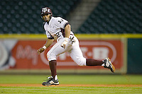 Kyle Colligan #12 of the Texas A&M Aggies takes off for second base versus the Houston Cougars in the 2009 Houston College Classic at Minute Maid Park March 1, 2009 in Houston, TX.  The Aggies defeated the Cougars 5-3. (Photo by Brian Westerholt / Four Seam Images)