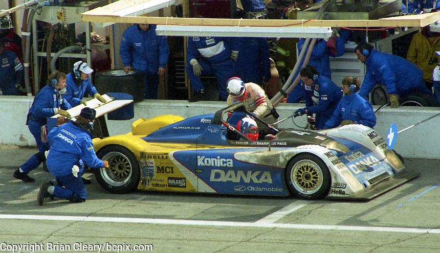 The #4 Oldsmobile Riley & Scott Mk III of Wayne Taylor, Scott Sharp, and Jim Pace makes a pit stop en route to victory in the 24 Hours of Daytona, IMSA race, Daytona International Speedway, Daytona Beach , FL, February 4, 1996.  (Photo by Brian Cleary/www.bcpix.com)