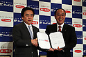 March 29, 2016, Tokyo, Japan - Japan Post Insurance president Masami Ishii (L) shakes hands with Dai-ichi Life Insurance president Koichiro Watanabe as they exchange documents on their agreement in Tokyo on Tuesday, March 29, 2016. Japan Post Insurance and Dai-ichi Life Insurance have reached basic agreement to form a strategic business alliance. (Photo by Yoshio Tsunoda/AFLO) LWX -ytd-