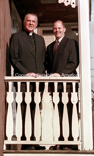 WATERBURY, CT 11/29/98 --1129JH04.tif--The Rev. Francis V. Karvelis, left, pastor of St. Joseph Church, and Waterbury Police Lt. Philip Rinaldi pose at the Lithuanian Club in Waterbury Sunday where they received community service awards during the Brooklyn Neighborhood Association's 2nd annual awards dinner. Also honored was Edward DiNapoli of Waterbury.  JOHN HARVEY staff photo for Gillis story.