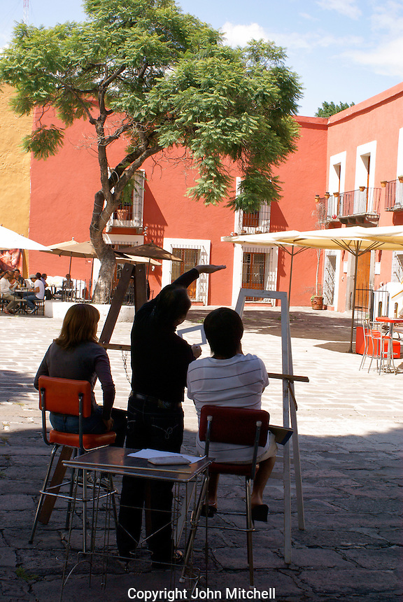 Art students and teacher in the Barrio del Artista, in the city of Puebla, Mexico