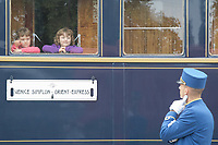 Steward watches children visiting cars of the Venice Simplon Orient Express open for the audience at the Hungarian Railway Museum in Budapest, Hungary on Aug. 26, 2018. ATTILA VOLGYI