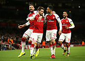 7th December 2017, Emirates Stadium, London, England; UEFA Europa League football, Arsenal versus BATE Borisov; Mathieu Debuchy of Arsenal celebrates after scoring his sides 1st goal in the 1st half to make it 1-0 with Francis Coquelin of Arsenal and Olivier Giroud of Arsenal