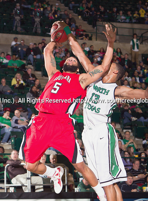 Louisiana Lafayette Ragin Cajuns forward J.J. Thomas (5) and North Texas Mean Green forward Tony Mitchell (13) in action during the game between the Louisiana Lafayette Ragin Cajuns and the University of North Texas Mean Green at the North Texas Coliseum,the Super Pit, in Denton, Texas. Louisiana Lafayette defeats UNT 57 to 53.