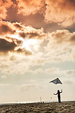 USA, Washington State, Long Beach Peninsula, International Kite Festival, Lorel Kirby flies her kite on the beach at the end of the day