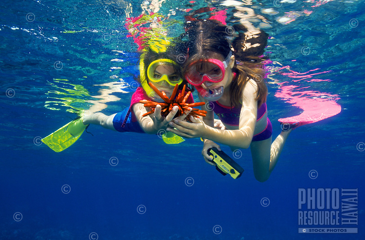 Two young girls snorkeling , Hanauma Bay, Oahu
