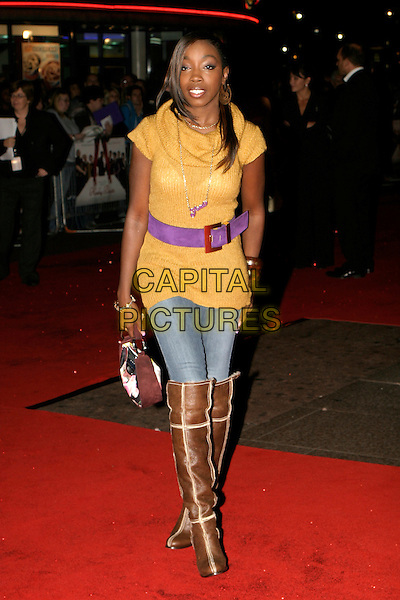 "ESTELLE .UK Premiere of ""Kinky Boots"" at the Vue West End, Leicester Square, London..October 4th, 2005.full length brown boots jeans tucked in denim yellow sweater purple belt.www.capitalpictures.com.sales@capitalpictures.com.© Capital Pictures."