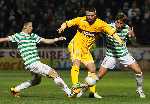 27.02.2013 Motherwell, Scotland.  Michael Higdon is sandwiched by Thomas Rogne and Beram Kayal during the Scottish Premier League game between Motherwell and Celtic from Fir Park.
