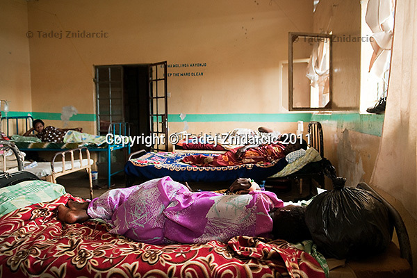 Expecting mothers lay on beds in the antenatal ward of Mityana Hospital , Uganda.