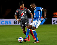 BOGOTA - COLOMBIA - 19 – 01 - 2018: Jair Palacios (Der.) jugador de Millonarios disputa el balón con Kevin Ramirez (Izq.) jugador de America de Cali, durante partido entre Millonarios y America de Cali, por el Torneo Fox Sports 2018, jugado en el estadio Nemesio Camacho El Campin de la ciudad de Bogota. / Jair Palacios (R) player of Millonarios vies for the ball with Kevin Ramirez (L) player of America de Cali, during a match between Millonarios and America de Cali, for the Fox Sports Tournament 2018, played at the Nemesio Camacho El Campin stadium in the city of Bogota.Photo: VizzorImage / Luis Ramirez / Staff.