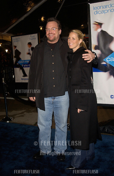 Actor TOM ARNOLD & wife at the Los Angeles premiere of Catch Me If You Can..16DEC2002.   © Paul Smith/Featureflash