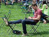 A reader uses his tablet computer in Bryant Park in New York on Thursday, June 7, 2012 (© Richard B. Levine)