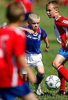 A player from Norwegian team Lørenskog dribbles his way through the defense of Lyn, another Norwegian team. Norway Cup is the worlds largest football tournament, in 2008 bringing together 30.000 children from all over the world, aged 10 to 19. They make up 1386 teams playing a total of 4400 matches during the week they play. The tournament is played on a big grass field just outside the center of Oslo, Norway.