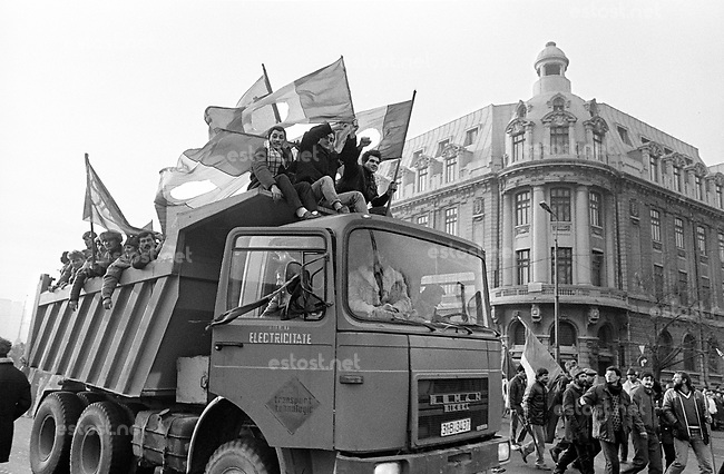 ROMANIA, University square., Bucharest, 23.12.1989, 1 pm..Manipulated by TV, people climb aboard trucks and rush to defend the tanks with their bare hands - 1000 people died as a result..© Andrei Pandele / EST&OST
