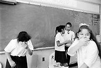 USA. New York City. Spanish Harlem. Sala (second from right) with her friends in the classroom of a public school. Puerto Rican girls. Spanish Harlem, also known as El Barrio and East Harlem, is a low income neighborhood in Harlem area. Spanish Harlem is one of the largest predominantly Latino communities in New York City. 20.10.86 © 1986 Didier Ruef ..