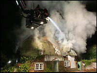 BNPS.co.uk (01202 558833)<br /> Pic :  DWFRS/BNPS<br /> <br /> Picture postcard thatched cottage in Dorset burnt down last night.<br /> <br /> More than 50 firefighters battled to extinguish a huge blaze at the idyllic thatched holiday cottage in Affpuddle.<br /> <br /> Peony Cottage, in the picturesque village of Affpuddle in Dorset, caught fire at around 7.20pm last night (Thurs).<br /> <br /> The five-bed property had been accommodating two families, thought to be on holiday from America, although no one was hurt in the fire.