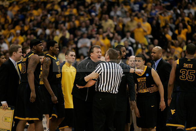 West Virginia head coach Bob Huggins complains to a ref about a questionable call at the Carrier Dome on Saturday, March 27, 2010. Photo by Scott Hannigan | Staff