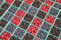 Blueberries, boysenberries and raspberries at a farmers market. Los Angeles, California