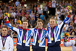 Mcc0041438 . Daily Telegraph..DT Sport..2012 Olympics..left to right ? Philip Hindes, Jason Kenny and Sir Chris Hoy of Team BG are flanked by France and Germany on the podium after winning the Gold Medal in the Olympic Men's Team Sprint at the Olympic velodrome in London ...2 August 2012...