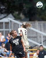 University of Central Florida midfielder Megan Fish (20) and Boston College midfielder Kate McCarthy (21) battle for head ball. After two overtime periods, Boston College tied University of Central Florida, 2-2, at Newton Campus Field, September 9, 2012.