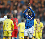 Sone Aluko walks towards the Rangers fans in BF1 and applauds them after the final whistle