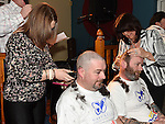 Ian McGoldrick and Kenny Lenihan have their heads shaved by Shauna McDonnell and Maria Galligan to raise funds for the Gary Kelly Cancer Support Centre in the Boyne Valley Inn Slane. Photo:Colin Bell/pressphotos.ie
