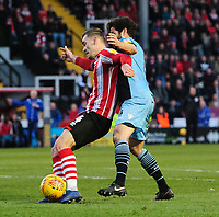 Lincoln City's Harry Toffolo under pressure from Stevenage's Michael Timlin<br /> <br /> Photographer Chris Vaughan/CameraSport<br /> <br /> The EFL Sky Bet League Two - Lincoln City v Stevenage - Saturday 16th February 2019 - Sincil Bank - Lincoln<br /> <br /> World Copyright © 2019 CameraSport. All rights reserved. 43 Linden Ave. Countesthorpe. Leicester. England. LE8 5PG - Tel: +44 (0) 116 277 4147 - admin@camerasport.com - www.camerasport.com