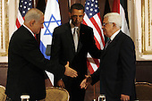 New York, NY - September 22, 2009 -- United States President Barack Obama greets Israeli Prime Minister Benjamin Netanyahu (L) and Palestinian President Mahmoud Abbas at a trilateral meeting at the Waldorf Astoria Hotel in New York City on Tuesday, September 22, 2009.  .Credit: John Angelillo / Pool via CNP