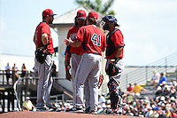 Minnesota Twins pitching coach Neil Allen (41) talks with pitcher Ervin Santana (54) as Trevor Plouffe (24) and catcher Kurt Suzuki (8) listen in during a Spring Training game against the Pittsburgh Pirates on March 13, 2015 at McKechnie Field in Bradenton, Florida.  Minnesota defeated Pittsburgh 8-3.  (Mike Janes/Four Seam Images)
