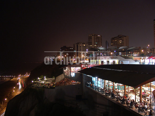 Night view of Larcomar Mall in the coast of Miraflores, fashionable district of Lima in the shore of the Pacific Ocean....Centro Comercial Larcomar en Miraflores, en la costa del Oceano Pacifico en Lima