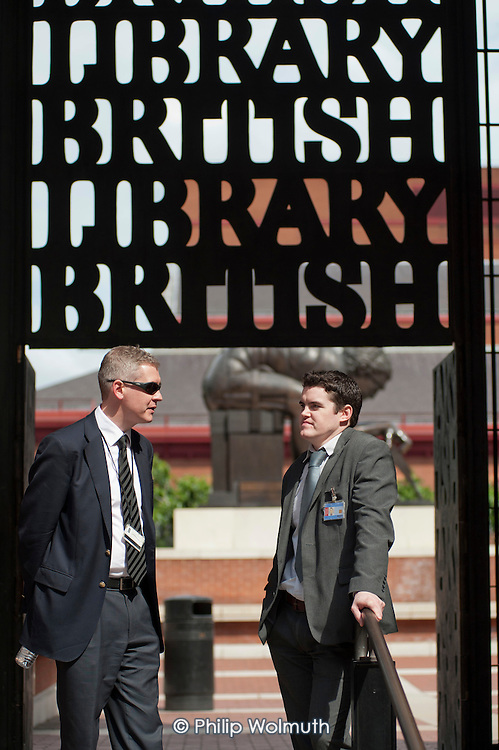 Managers guard the British Library as public sector workers strike over planned pension changes.