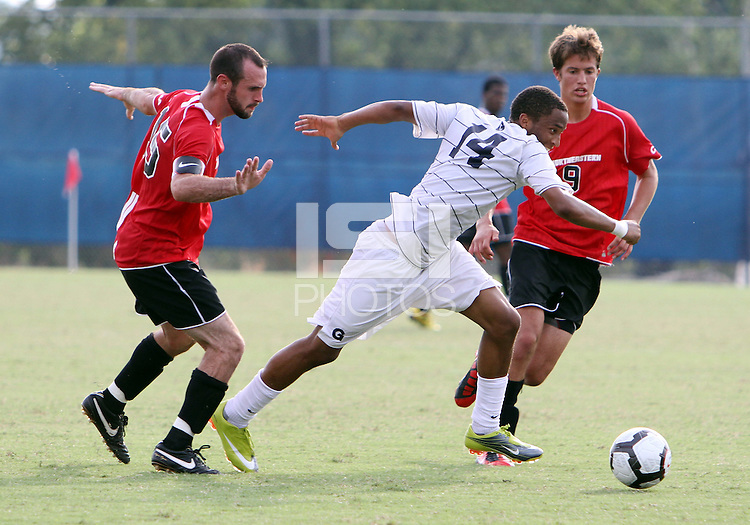 Chandler Diggs #14 of Georgetown University strides past Brendan Ennis #15 of Northeastern University during an NCAA match at North Kehoe Field, Georgetown University on September 3 2010 in Washington D.C. Georgetown won 2-1 AET.