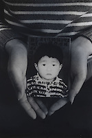 Mrs Tang, 26, holds a picture of her only son, Chen Zhijie, 5 years and 3 months, who was stolen, she believes by a neighborhood gang. Message read &quot;My poor son where are you? I miss you very much. Are you okay now? Please come back. Mum can't live without you. Mum dreams of you every night, dreaming that have come back to our sides. Don't know when can our dream comes true.&quot;<br /> Feb 2007<br /> <br /> photo by Richard Jones / Sinopix